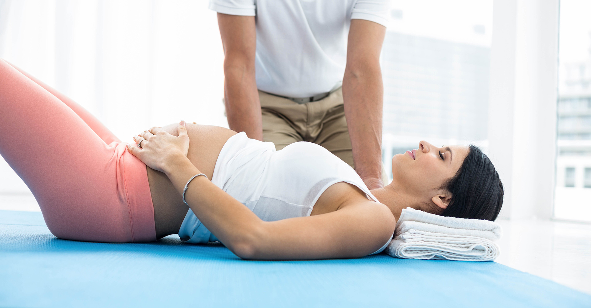 Chiropractor adjusting a pregnant woman's spine